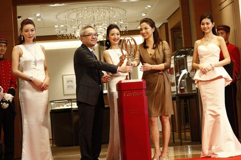 Smile, Event, Trousers, Flooring, Dress, Shirt, Coat, Red, Outerwear, Formal wear,