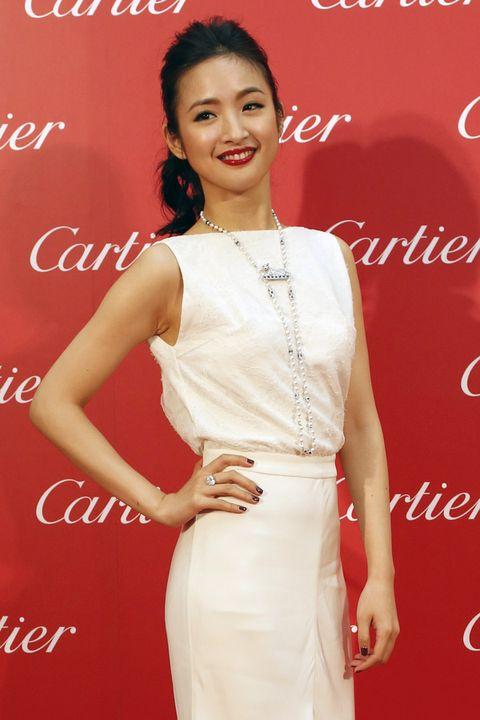 Human, Skin, Shoulder, Dress, Joint, Red, Eyelash, Jewellery, Fashion accessory, Style,