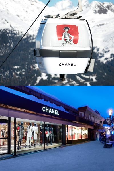 Transport, Cable car, Signage, Cable car, Street light, Travel, Mountain range, Advertising, Commercial building, Sign,