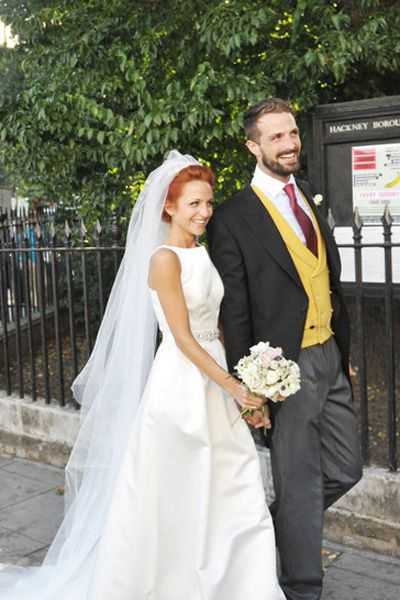 Clothing, Trousers, Dress, Coat, Bridal clothing, Bridal veil, Photograph, Wedding dress, Veil, Outerwear,