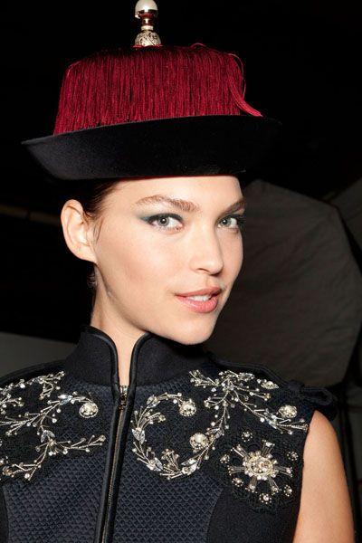 Lip, Hairstyle, Headgear, Fashion accessory, Costume accessory, Fashion, Costume hat, Eye liner, Earrings, Fashion model,