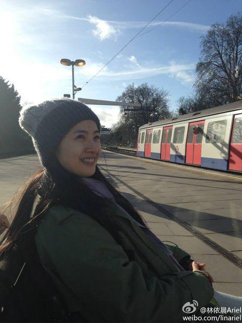Transport, Winter, Railway, Rolling stock, Travel, Passenger car, Public transport, Train, Black hair, Beanie,