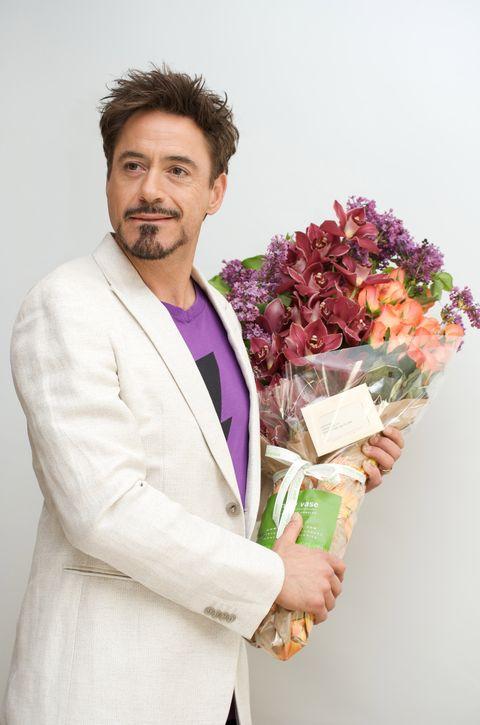 Sleeve, Facial hair, Petal, Bouquet, Moustache, Coat, Beard, Collar, Cut flowers, Blazer,