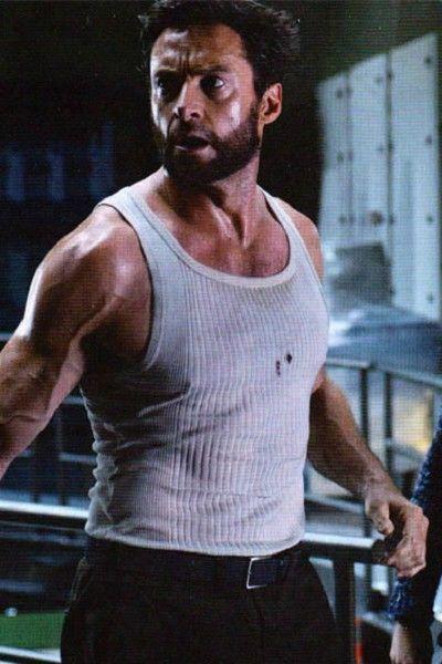 Arm, Human body, Shoulder, Sleeveless shirt, Chest, Standing, Joint, Elbow, Undershirt, Sportswear,