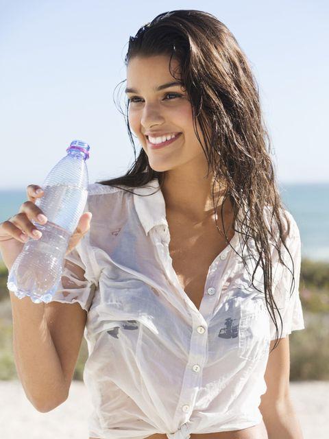 Hairstyle, Skin, Liquid, Fluid, Plastic bottle, Happy, Bottle, Drinkware, Black hair, Beauty,