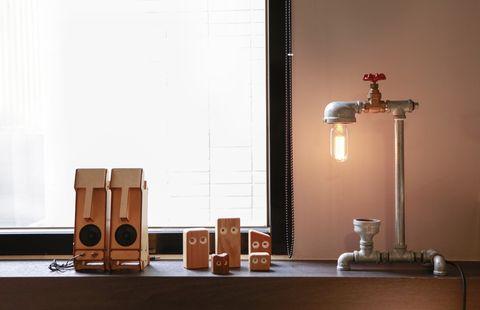 Wood, Wood stain, Tan, Interior design, Light fixture, Still life photography, Varnish, Plywood, Lamp, Loudspeaker,