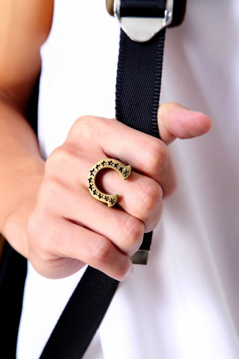 Finger, Hand, Thumb, Nail, Jewellery, Metal, Body jewelry, Ring, Gesture, Wedding ceremony supply,
