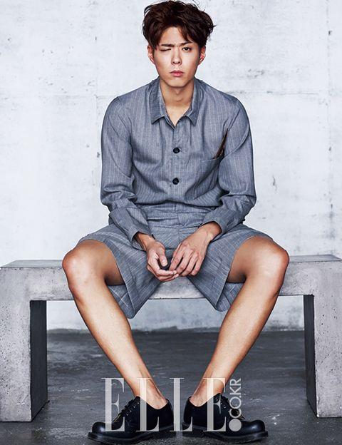 Clothing, Leg, Dress shirt, Collar, Sleeve, Sitting, Shirt, Human leg, Denim, Style,
