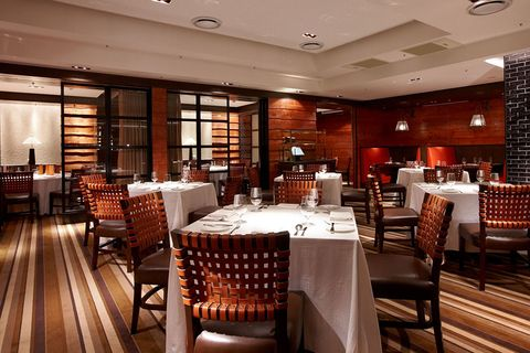 Lighting, Room, Furniture, Table, Chair, Interior design, Ceiling, Restaurant, Light fixture, Hardwood,