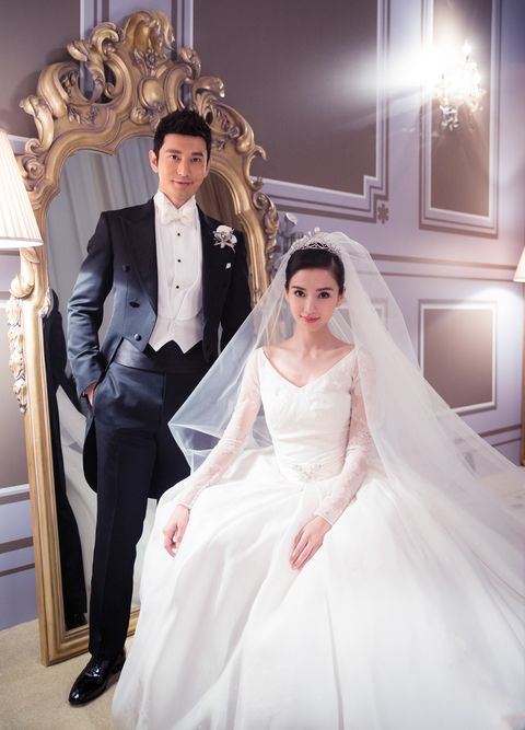 Clothing, Lighting, Sleeve, Trousers, Coat, Bridal clothing, Dress, Photograph, Outerwear, Suit,