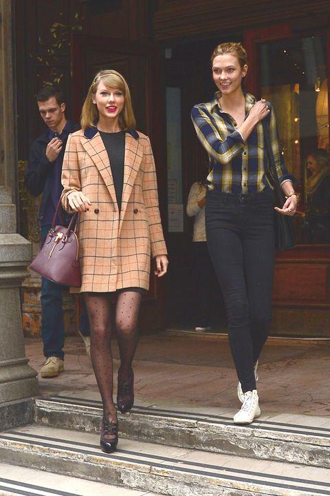 Footwear, Leg, Brown, Sleeve, Joint, Outerwear, Human leg, Coat, Style, Street fashion,