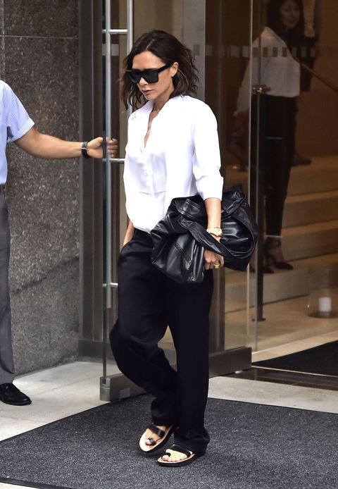 Clothing, Eyewear, Footwear, Arm, Leg, Trousers, Shoulder, Sunglasses, Outerwear, Standing,
