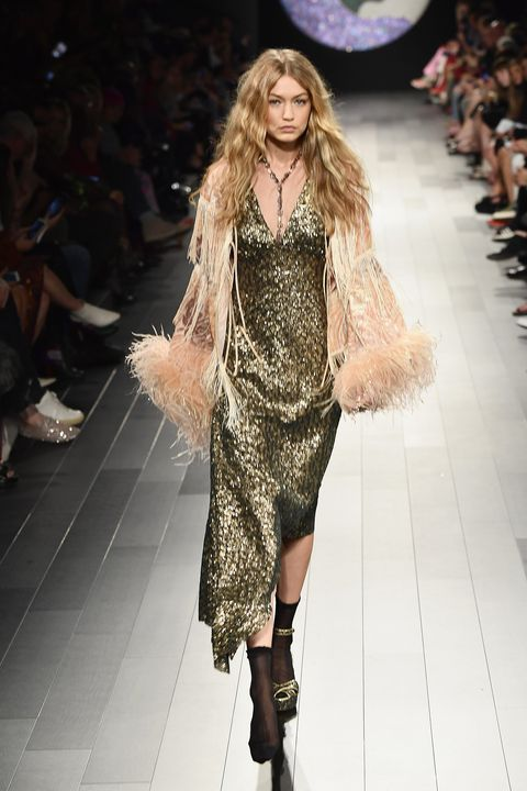 Fashion show, Fashion model, Fashion, Runway, Clothing, Public event, Fur, Fur clothing, Event, Long hair,