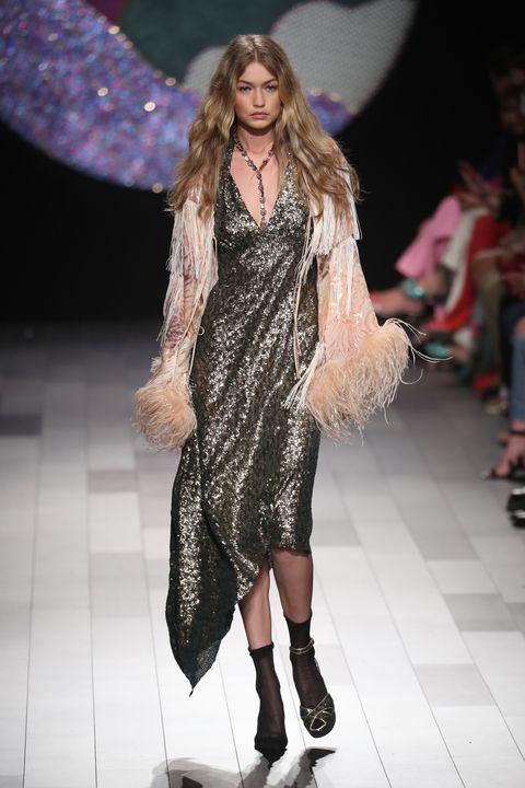 Fashion model, Fashion show, Fashion, Runway, Clothing, Footwear, Public event, Event, Fur, Long hair,