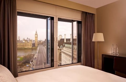 Interior design, Glass, Room, Bed, Lamp, Real estate, Fixture, Interior design, Linens, Window treatment,