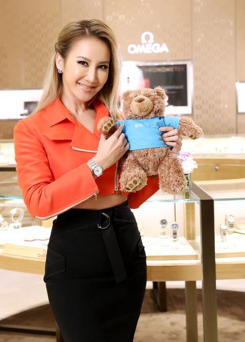 Collar, Waist, Brown hair, Toy, Teddy bear, Belt, Employment, Pocket, Pencil skirt, Button,