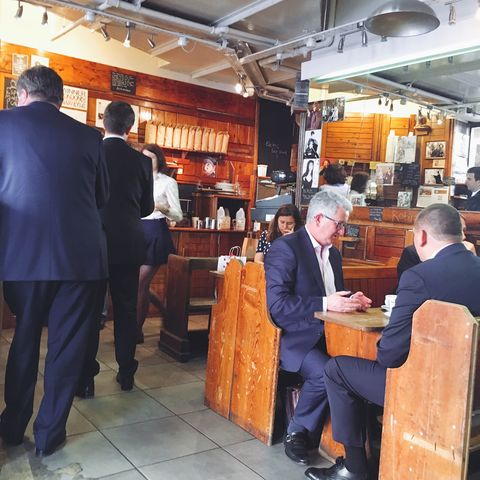 Lighting, Suit, Shelf, Customer, Suit trousers, Light fixture, Varnish, Business, Cabinetry, Shelving,