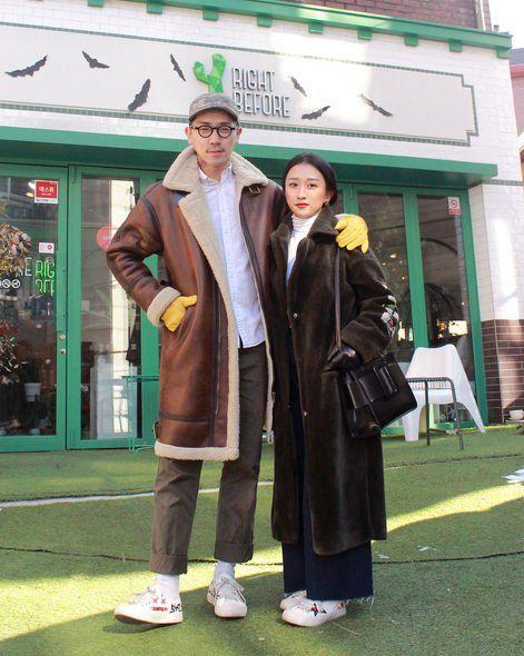 Green, Snapshot, Standing, Outerwear, Street fashion, Photography, Overcoat, Uniform, Street, Jacket,