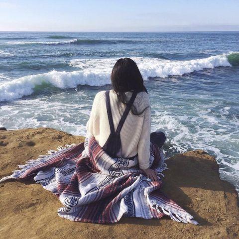 Coastal and oceanic landforms, Water, Textile, Ocean, Summer, Sitting, Coast, Wave, Beach, Sea,