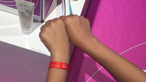 Finger, Skin, Wrist, Joint, Purple, Magenta, Human leg, Pink, Violet, Nail,