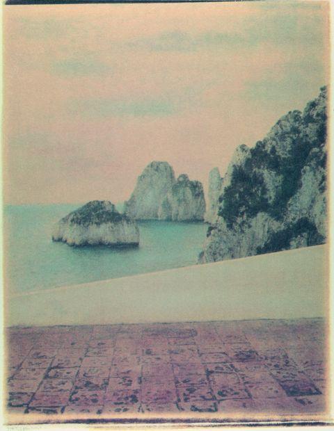 Body of water, Photograph, Coastal and oceanic landforms, Rock, Geology, Art, Rectangle, Bedrock, Aqua, Island,