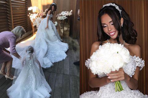 Clothing, Dress, Bridal clothing, Textile, Wedding dress, Petal, Photograph, Veil, Bridal veil, White,