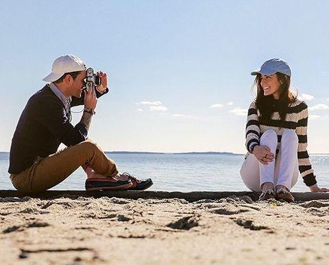 Human body, Cap, Mammal, People in nature, Sitting, Headgear, Vacation, Travel, People on beach, Beach,