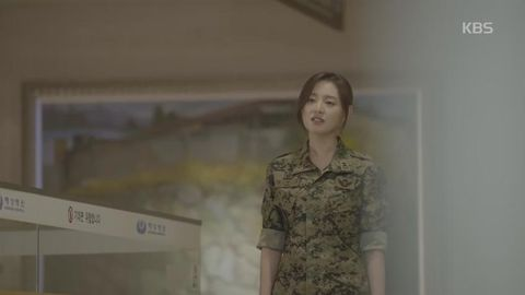 Soldier, Brown, Hairstyle, Skin, Sleeve, Chin, Forehead, Shoulder, Military camouflage, Eyebrow,