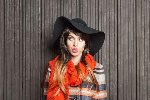 Clothing, Lip, Hat, Textile, Collar, Street fashion, Headgear, Fashion, Jacket, Fashion model,