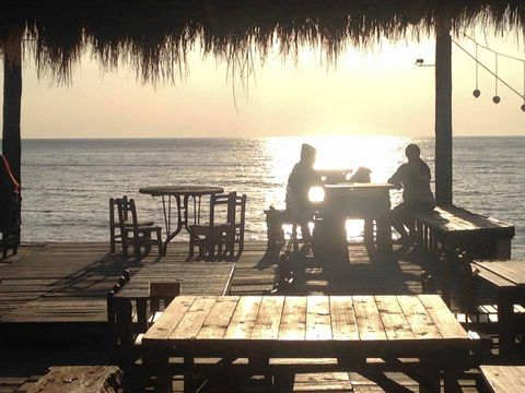 Table, Outdoor table, Vacation, Outdoor furniture, Sea, Tints and shades, Dock, Sunset, Evening, Beach,