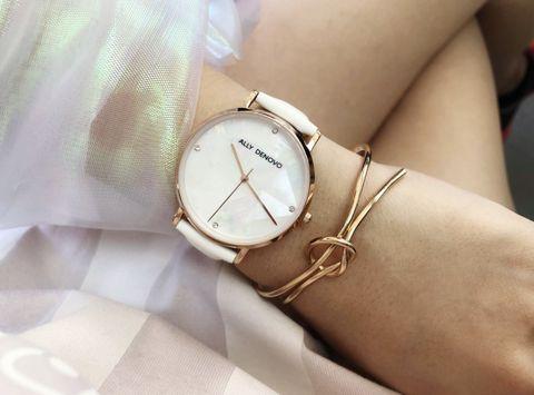 Analog watch, Wrist, Watch, White, Fashion accessory, Watch accessory, Fashion, Jewellery, Hand, Brand,
