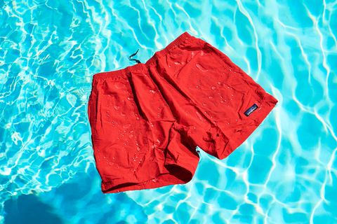 a pair of red shorts floating in a swimming pool