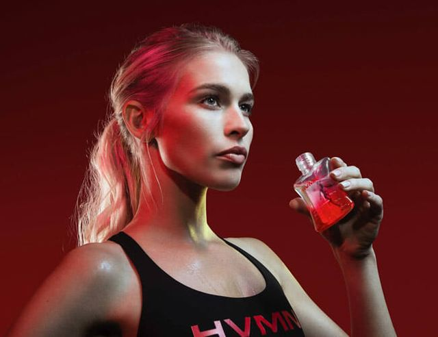 a blonde woman holding a bottle of ketones