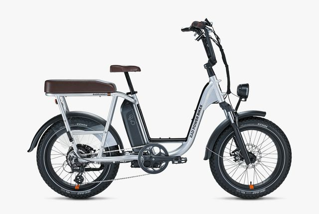 a compact silver e bike with an extra seat on a white background
