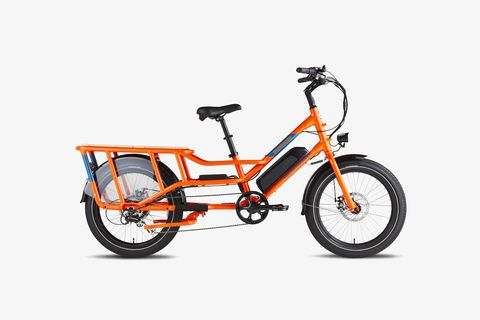 an orange e bike with a bench above the rear wheel