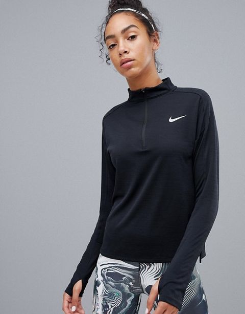 56121b150a284 Another affordable, yet important layer to have in your wardrobe, you can't  go wrong with this half-zip layer from Nike. Features include a high neck  for ...