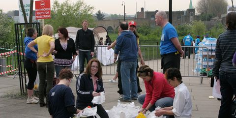 Footwear, Public space, Luggage and bags, Pole, Backpack, Plastic bag, Handbag, Picnic, Street artist, Plastic,