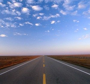 Road, Nature, Blue, Daytime, Sky, Brown, Natural environment, Road surface, Atmosphere, Cloud,