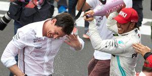 Lewis Hamilton, right, and Mercedes team principal Toto Wolff celebrateHamilton'ssixth F1 drivers title.