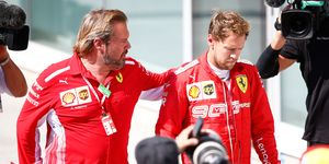 A dejected Sebastian Vettel, right, heads to the podium ceremony after the F1 Canadian Grand Prix on Sunday.