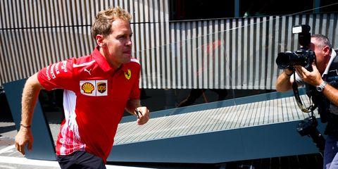 Four-time F1 champion Sebastian Vettel, left, is not exactly running away from retirement talk.