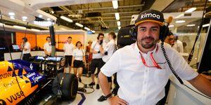Fernando Alonso checks out the McLaren F1 garage at Abu Dhabi.