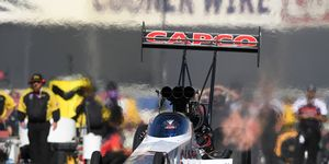 Steve Torrence won his second Top Fuel championship by the slimmest of margins on Sunday.