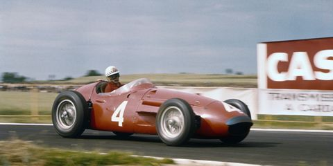 Jean Behra drives a Maserati 250F at the 1956 French Grand Prix in Reims. The race was held July 1; Behra took third place, behind the Ferraris of Peter Collins and Eugenio Castellotti.