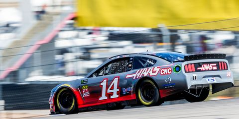 The No. 14 Haas Automation Ford Mustang makes a demonstration run during previews ahead of the F1 Grand Prix of USA at Circuit of The Americas on October 31 in Austin, Texas.