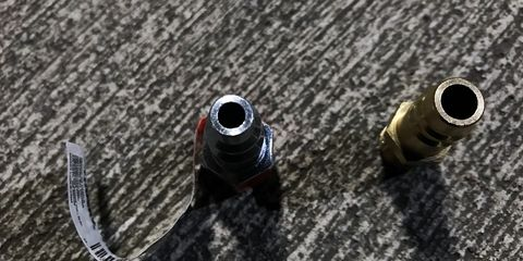 """Pictured left is a traditional, steel, quarter-inch air fitting. Right, is the Milton 760 high-flow """"V"""" style fitting."""