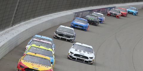 """<span id=""""CT_Main_1_cache_lblCaption"""">Joey Logano leads a pack of cars during the NASCAR Cup Series FireKeepers Casino 400 at Michigan International Speedway.</span>"""