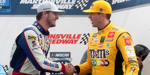 Todd Gilliland shakes hands with team owner Kyle Busch following their victory in the NASCAR Hall of Fame 200.