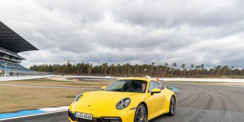 Land vehicle, Vehicle, Car, Supercar, Yellow, Sports car, Automotive design, Coupé, Performance car, Luxury vehicle,