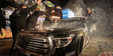 Greg Biffle celebrates in Victory Lane after winning the NASCAR Gander Outdoors Truck Series SpeedyCash.com 400 at Texas Motor Speedway.